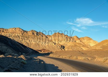 Artists Drive in Death Valley National Park with golden light in California