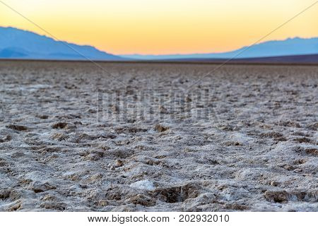 View of salt flats in Badwater Basin near sunset in Death Valley National Park in California