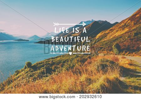 Travel inspirational quotes - Life is a beautiful adventure. Blurry retro styled background.