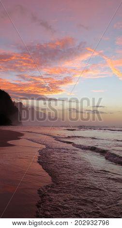 Beach scene at sunset Kauai Hawaii USA