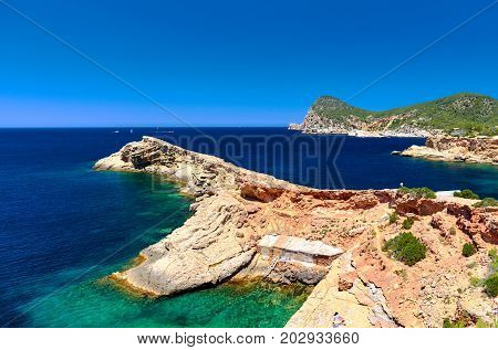 Picturesque beach of Punta Galera is an amazing bay surrounded by stone formations. Balearic Islands. Spain