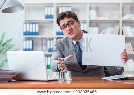 Businessman  in office holding a blank message board