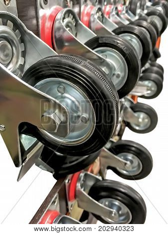 Wheels for a cart or furniture on a stand in a supermarket isolated on a white background
