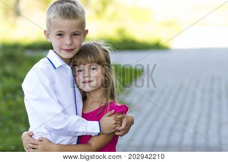Portrait of children boy and girl embracing together. Love care and family relations concept