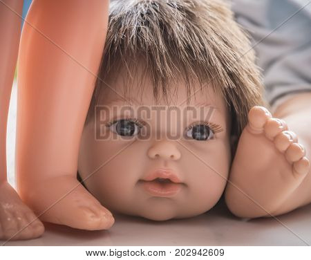 Old Doll Head Detail, conceptual image, abstract