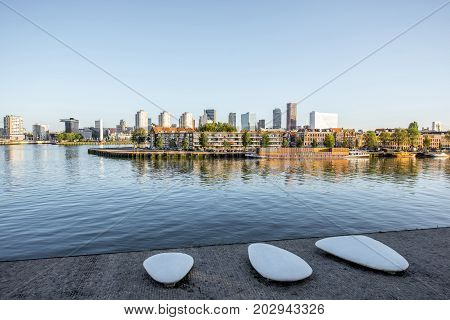 Landscape view on the riverside with beautiful buildings during the morning in Rotterdam city