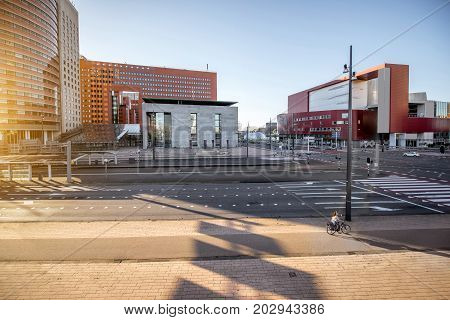 View on the street at the office district with modern theatre during the morning in Rotterdam city