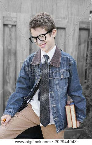 Young Preteen Boy Smiling, Holding Books, Pencils And Leather Bag Outdoors, Ready For School