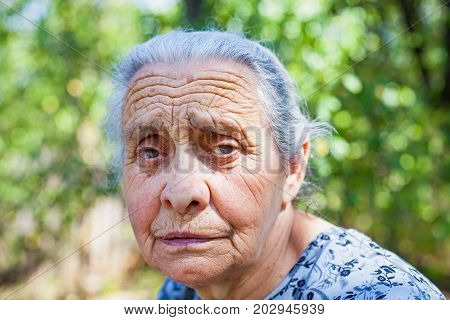 Worried senior woman portrait looking at the camera outdoor