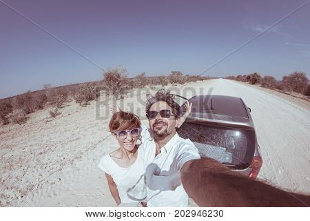 Adult Couple Selfie On Road Trip In The Desert, Namib Naukluft National Park, Travel Destination In