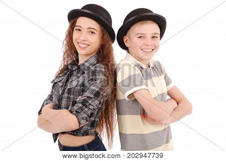 Portrait of young girl and boy posing in black bowler hat isolated on white