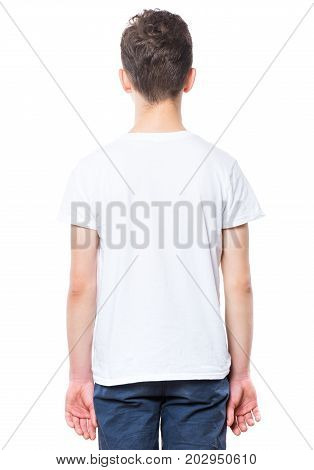 White t-shirt on teen boy. Close-up of back tshirt, isolated on a white background. Concept of childhood and fashion or advertisement design. Mock up template for design print.