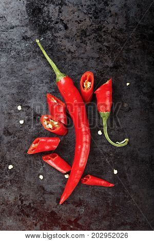 hot pepper cut on a black background composition of pepper slices and seeds space for text