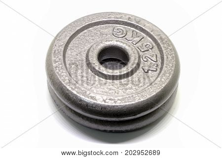 1.25KG plate for dumbbell and babel to enhance the performance of the body Isolated on white background
