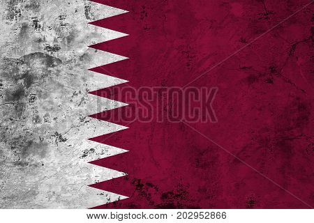 Flag of the Qatar against the background of the stone texture
