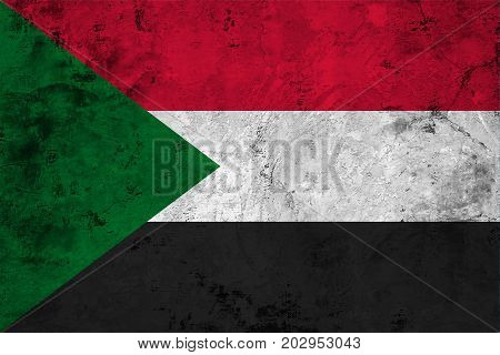 Flag of the Sudan against the background of the stone texture