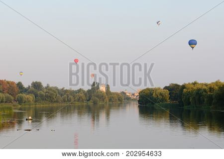 BILA TSERKVA UKRAINE - AUGUST 26: The view on balloons are over Ros river in Bila Tserkva town on August 26 2017 in Bila Tserkva Ukraine. The balloons show is dedicated to Ukrainian Independence Day.