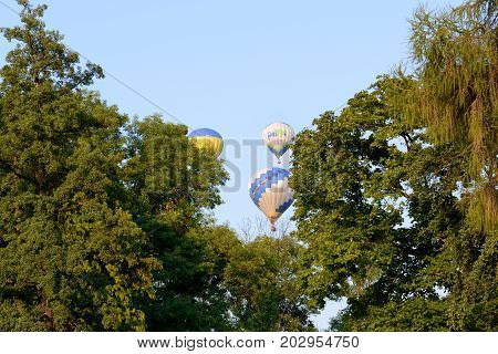 BILA TSERKVA UKRAINE - AUGUST 27: The view on balloons are over Olexandria Park and trees on August 27 2017 in Bila Tserkva Ukraine. The balloons show is dedicated to Ukrainian Independence Day.