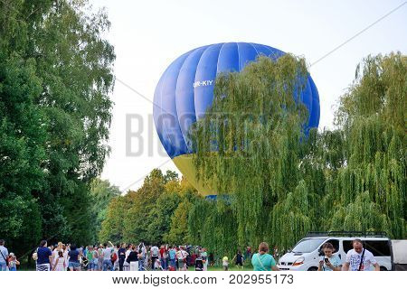 BILA TSERKVA UKRAINE - AUGUST 26: The view on balloons are over Olexandria Park and visitors on August 26 2017 in Bila Tserkva Ukraine. The balloons show is dedicated to Ukrainian Independence Day.