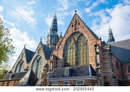 Old Church - Oude Kerk - the oldest building and oldest parish church, founded in 1213, Amsterdam, Netherlands. It stands in De Wallen, now Amsterdam's main red-light district.