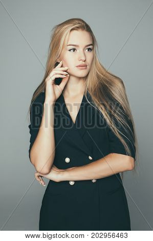 Beauty Woman Face Portrait. Beautiful Model . Blonde Female Looking At Camera And Smiling On Gray Ba
