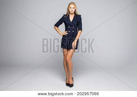 Full Length Portrait Of A Sexy Blonde Woman In Little Black Fashion Dress On Gray