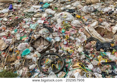 Mandalay, Myanmar - October 17, 2016: Spontaneous unofficial dump in Myanmar. Garbage pollution background