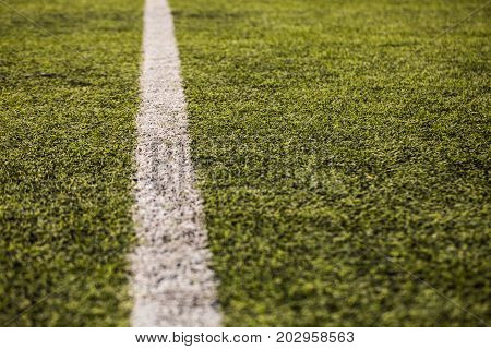 green grass pattern for football sport, Football field, soccer field, team sport texture. White stripe on it. Close up focus
