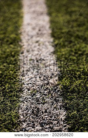 green grass pattern for football sport, Football field, soccer field, team sport texture. White stripe on it. Close up focus. Macro photo.