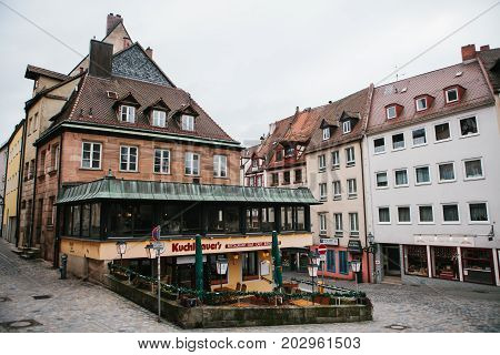 Germany, Nuremberg, December 27, 2016: View of the popular restaurant called Kuchlbauers located near the Nuremberg castle. Favorite place for visiting tourists. Older style buildings.