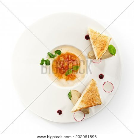 Pate of fowl with toast and citrus jam with radish slices and fresh herbs on flat white plate. Gastronomic restaurant menu. Top View