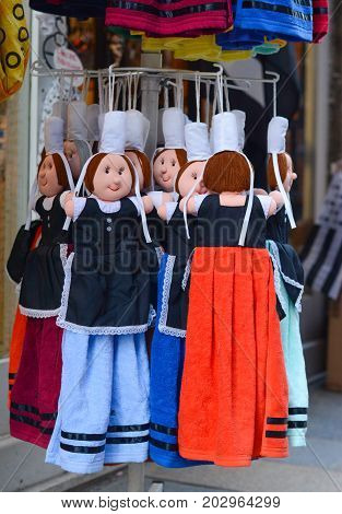 dolls in national costumes are hanging on the market for sale Brittany dolls.