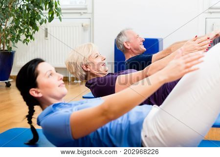 Physio giving gymnastic class for seniors