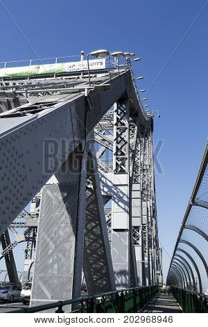 BRISBANE, AUSTRALIA - August 29, 2017: Detail of the Story Bridge a steel cantilever bridge spanning the Brisbane River and carrying vehicular bicycle and pedestrian traffic in Brisbane Australia.