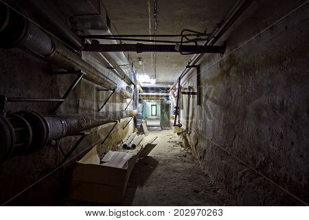 Underground cellar room with water heating pipes