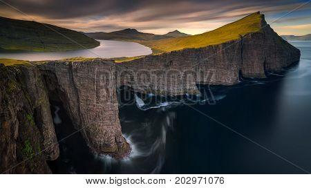 Sorvagsvatn lake on cliffs of Vagar island in sunset Faroe Islands