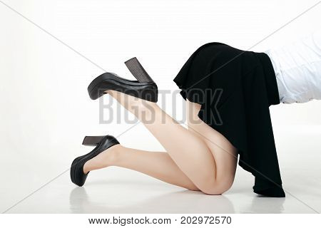 Sensual woman bend over on white background. Vulgar provocative shoot of doggy style position. ready for spanking.