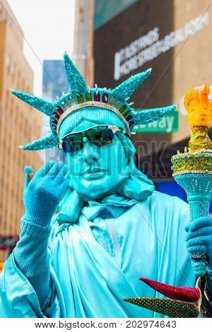 New York USA - September 27 2016: Street Performer dressed as the statue of liberty available for tourist photographs in Times Square.