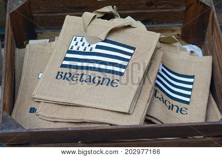 brittany flag on bag-souvenir on the market in Saint Malo in France