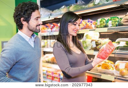 Couple choosing food in a supermarket