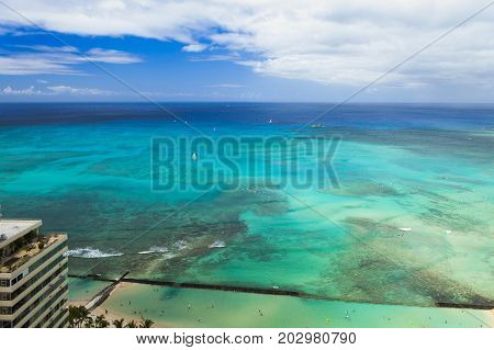 waikiki beach and pacific ocean  aerial view with multiple water colours hawaii