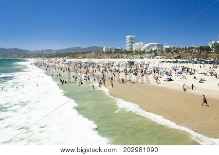 santa monica june 2012: bathers and joggers flock to the long sun kissed beach in santa monica california