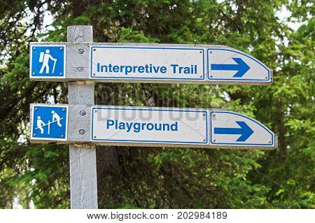 A Direction Sign For An Interpretive Trail And Playground