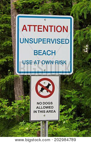 An Attention Unsupervised Beach With No Dogs Allowed Sign