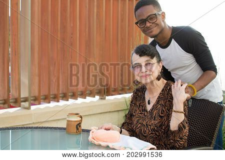 Closeup portrait relatives sitting and hugging each other isolated outdoors background