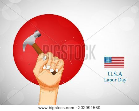 illustration of hand holding hammer and usa flag with U.S.A. Labor Day text on the occasion of Labor Day