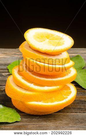 Stack of Navel orange fruit slices on wooden background,healthy fruit