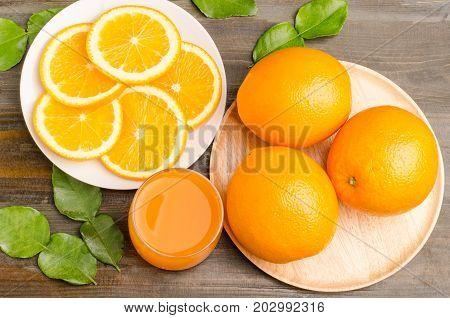 Navel orange fruit and juice on wooden background, healthy fruit