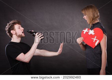 Angry Woman And Man Addicted To Alcohol. Broken Heart.