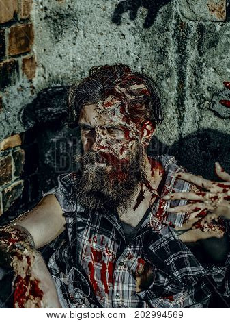Halloween Zombie Stretching Bloody Hands To Man